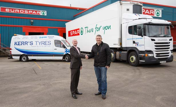 Pictured (left to right): Greg Gilmour, Transport Manager, Henderson Group and Norman Kerr, Managing Director, Kerr's Tyres on the signing of a three year tyre deal to supply and fit tyres under an innovative Pence Per Kilometre contract designed to slash Henderson's tyre bill in half.