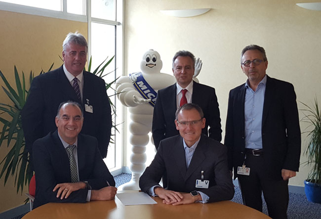 Photo (l to r) Sid Sadique (CEO NRG Group – seated), Steve Richardson (MD of NRG Group), Laurent Bourrut (Michelin European Truck Director), Guy Heywood (Michelin North Europe Truck Commercial Director - seated), Patrick Derossis (Michelin European Truck Sales Director)